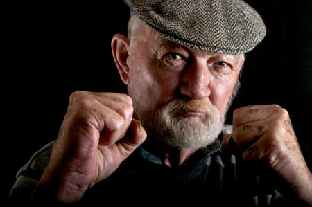 Old man fighting Stock Photo
