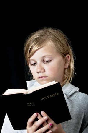 bible reading: sad girl reading the bible Stock Photo