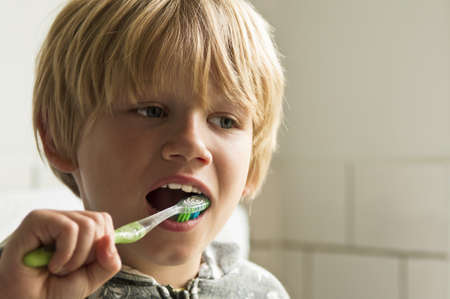 Boy cleaning teeth Stock Photo