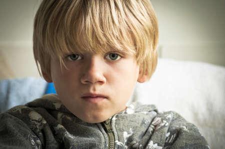 homeless children: Boy with sad eyes Stock Photo