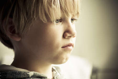lonely boy: Upset child Stock Photo