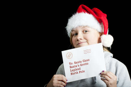Girl with christmas letter for santa photo