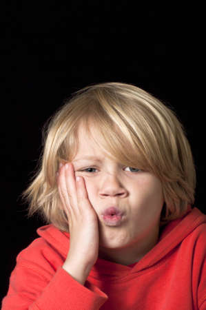 blond boy: Toothache