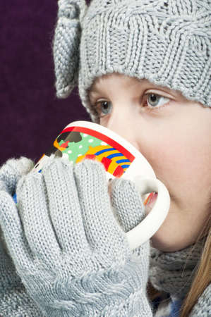 Child with hot drink photo