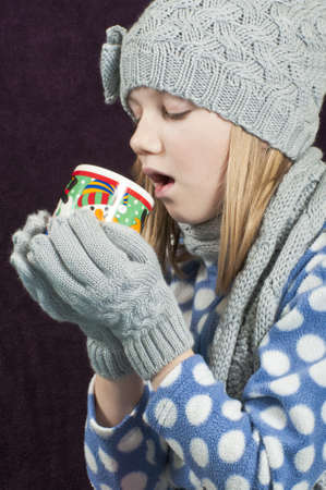 Girl with hot beverage photo