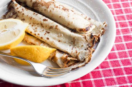 Pile of hot pancakes with lemon Stock Photo - 17670686