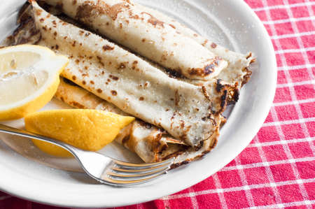 shrove tuesday: Pile of hot pancakes with lemon