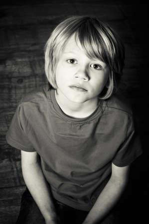 suffer: Sad boy Stock Photo