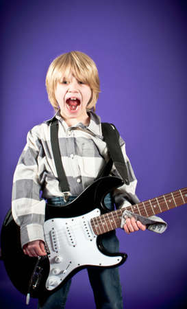 Boy with electric guitar photo