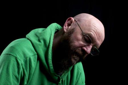throbbing: Sad bald man