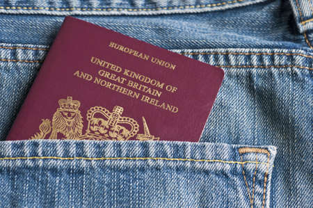 british people: Passport in back pocket Stock Photo
