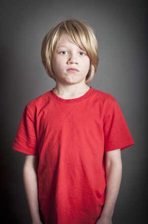 child poverty: Upset boy