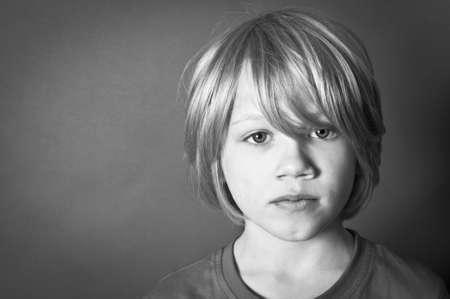 homeless children: frightened boy Stock Photo