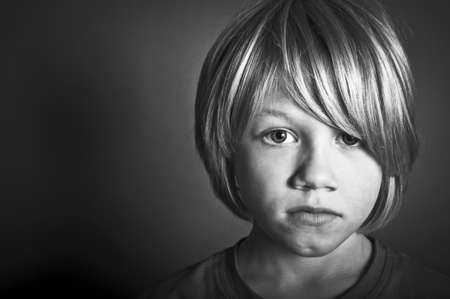 crying boy: Child abuse