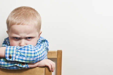 child alone: Angry child Stock Photo