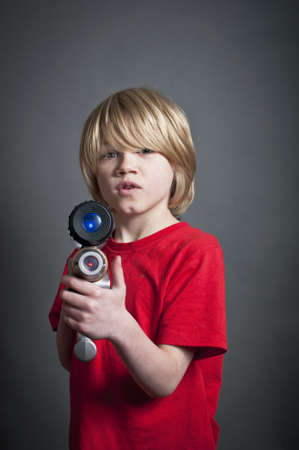 Child with a toy laser gun Stock Photo