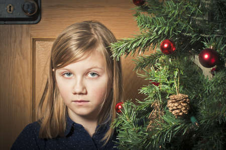 Sad girl at christmas Stock Photo