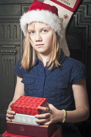Child with christmas presents Stock Photo - 21452454