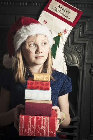 Happy child with a pile of christmas presents Stock Photo - 21452460