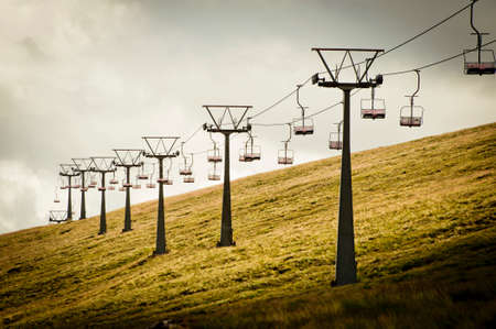 cableway: Storm clouds over mountain ski lift