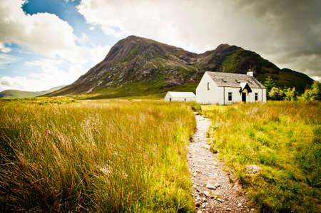 Old cottage at glencoe in scotland Standard-Bild