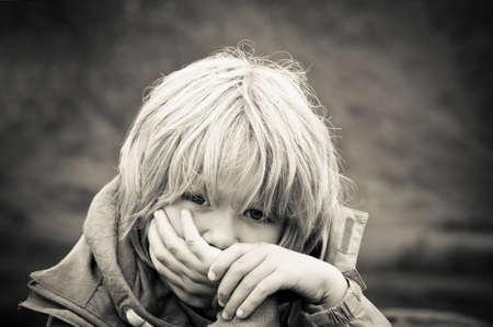 child poverty: Upset little boy