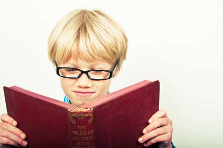 intelligently: Boy reading a book