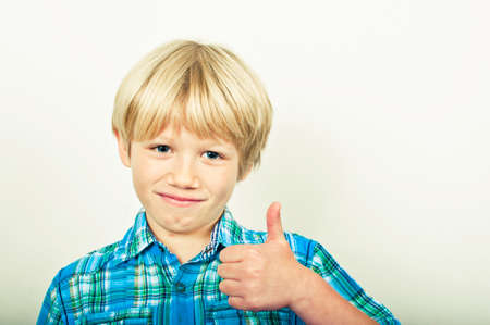 Happy boy with thumbs up Stock Photo