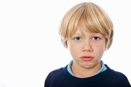 Grumpy school boy Stock Photo