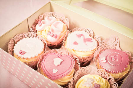 Box of fancy cupcakes photo