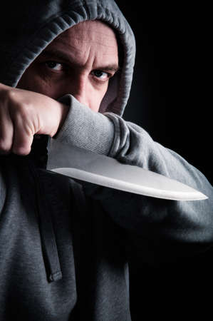Street robber holding a knife photo