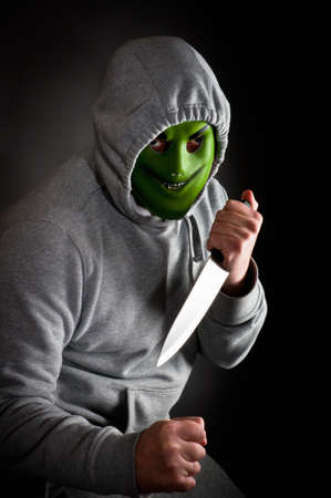 Violent gang member armed with a knife Stock Photo