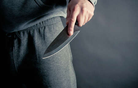 Robber thrusting a knife Stock Photo