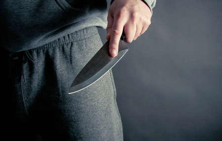 Robber thrusting a knife Standard-Bild