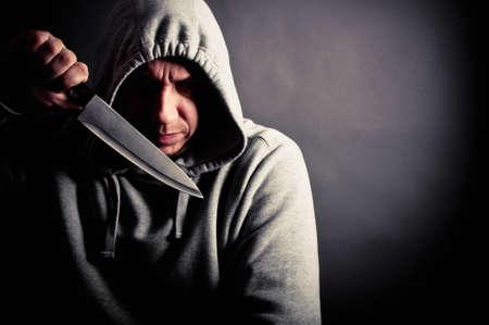 Violent man holding a knife