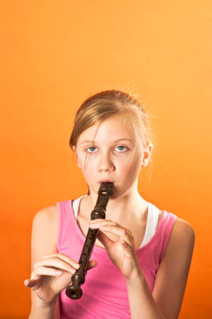 Young child playing a wind instrument photo