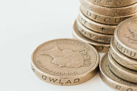 toppled: Pound coins the British currency Stock Photo