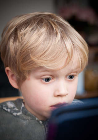 internet safety: Small child shocked by the internet