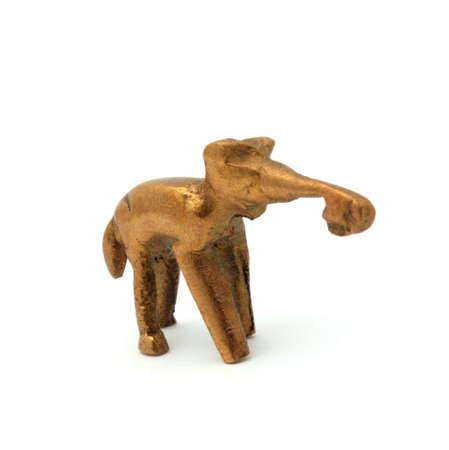 golden elephant on white background photo