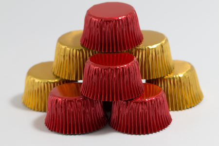 cake pick: Aluminum baking cup in golden colour Stock Photo