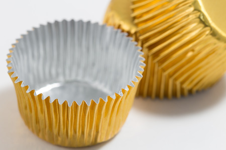 dragees: two aluminum baking cup in golden colour