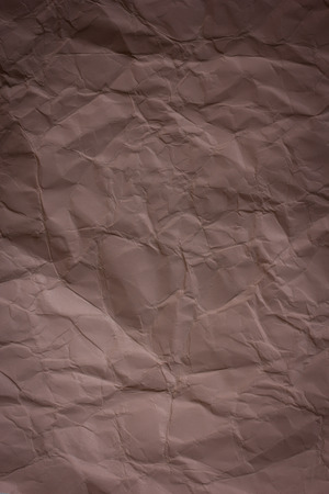 Brown crumpled paper background texture photo