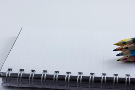 blank notebook isolated on white background photo