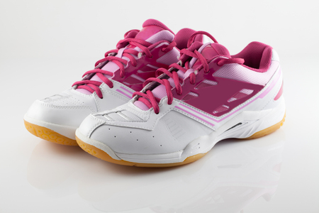 Badminton shoes on pink color isolate photo