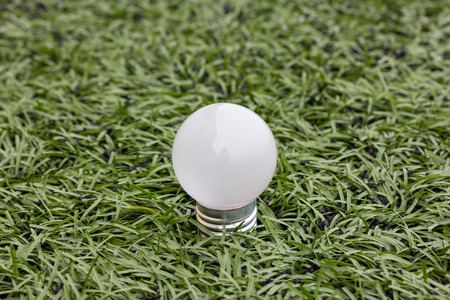 Lamp in green grass background on morning photo