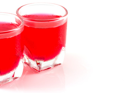 a glass of red water isolate in white background photo