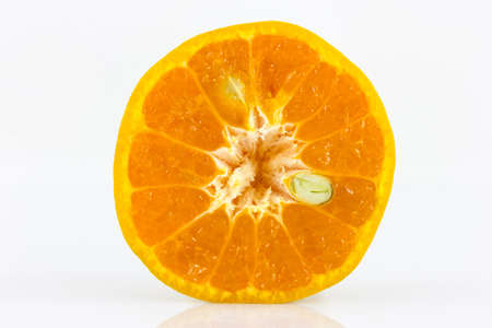 Orange sliced in half wite seed isolate in white background photo