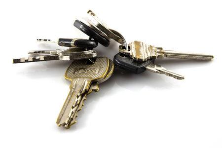 Large bunch of keys isolate on white background photo