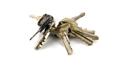 Large bunch of keys isolate on white background Reklamní fotografie