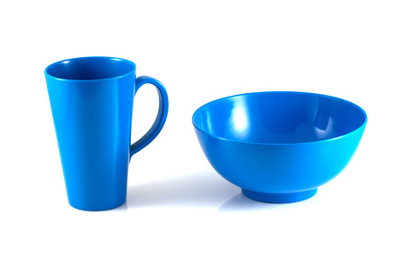 Blue disk and green cup isolate on white background photo